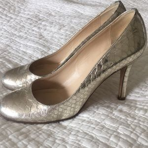 Kate Spade gold snakeskin almond toe pumps